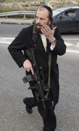 Armed Israeli settler